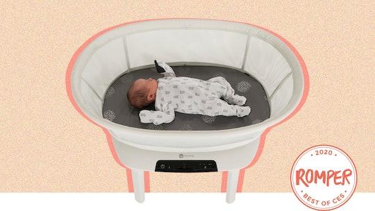 a baby in a 4moms mamaroo sleep bassinet