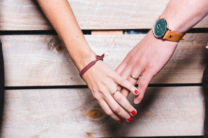 A couple loosely holds hands. Relationship troubles could be behind someone's inability to get an erection.