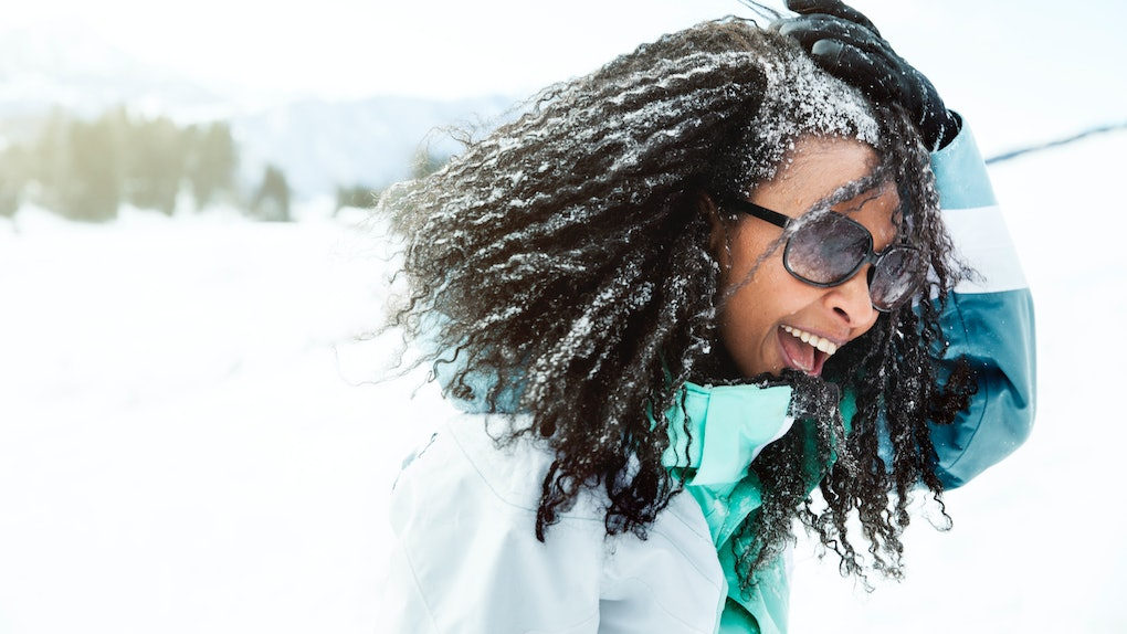 Young Black woman with snow in her hair
