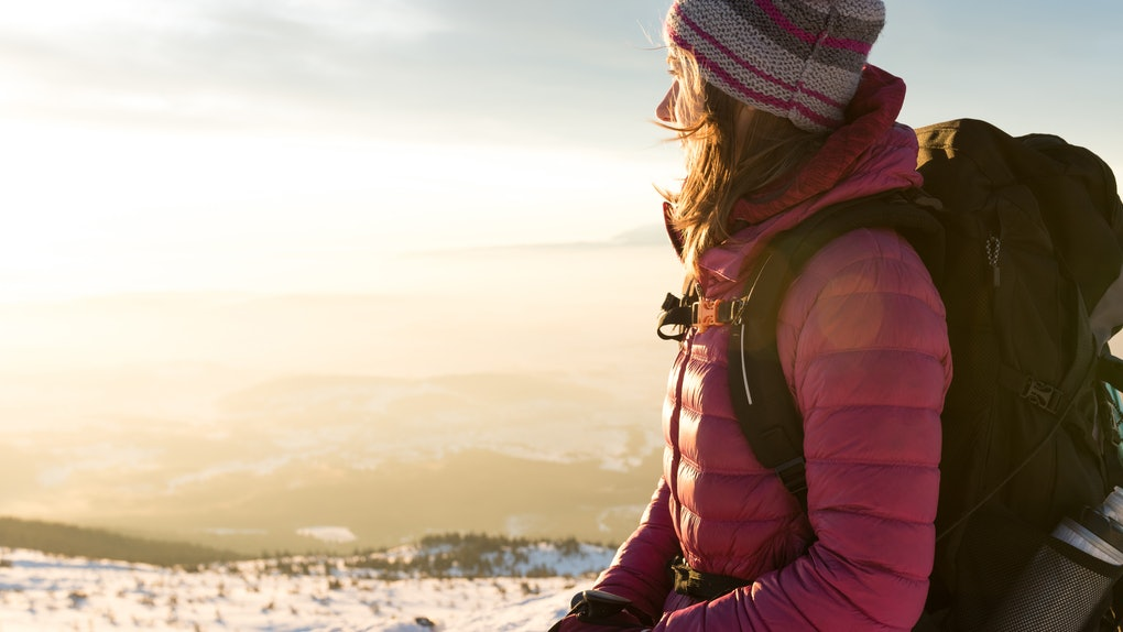 Young woman on snowy mountain