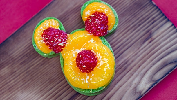 The Mandarin Orange Green Tea Tart is Mickey Mouse-shaped and served at Disneyland's Lunar New Year celebration.