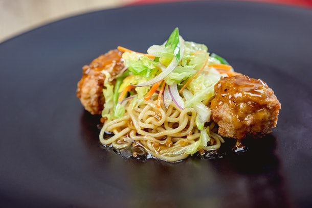The chicken meatballs and lo mein noodles is served at Disneyland's Lunar New Year celebration.