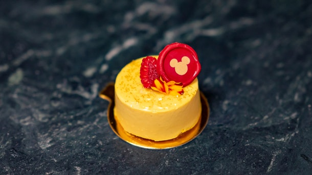 The Mango Mousse at Disneyland's Lunar New Year celebration has a Mickey Mouse decoration on top.