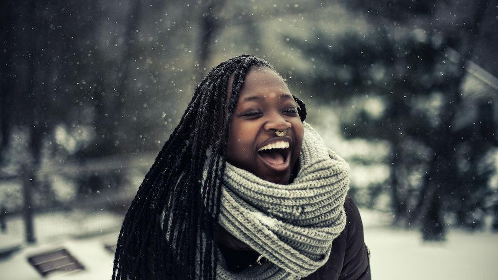Young Black woman enjoying the snow