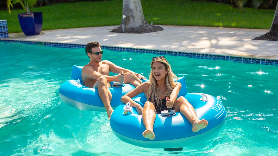 a man and woman in poolcandy motorized pool floats