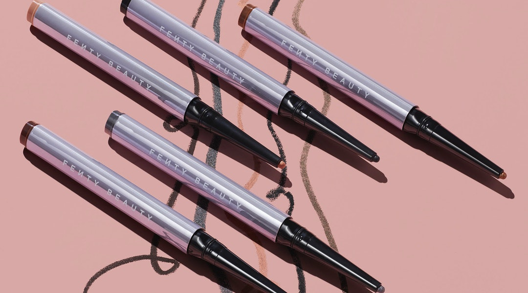 Fenty Beauty's new Flypencil Longwear Eyeliner is the brand's first pencil eyeliner, featured in matte, metallic, shimmer, and glitter shades.