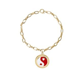 Wilhemina Garcia's gold yingyang red bracelet.