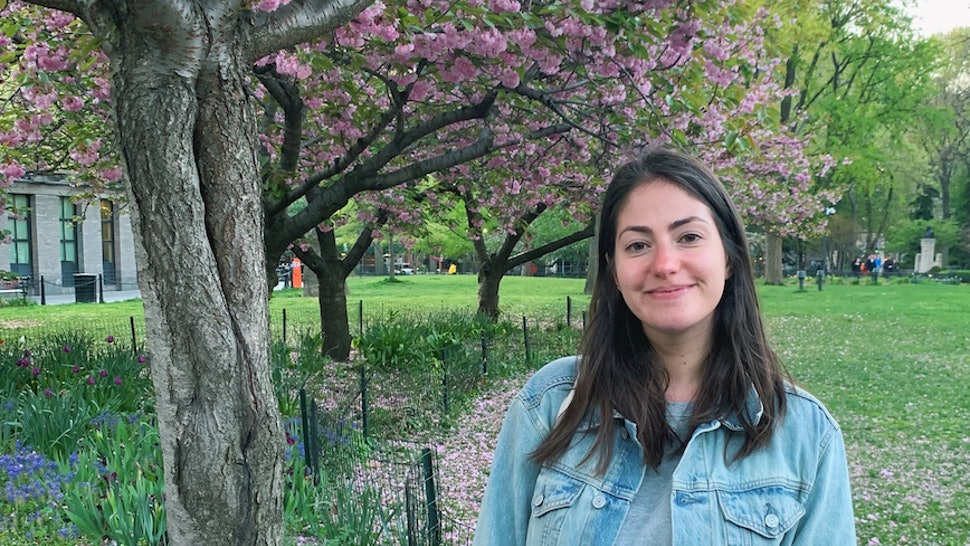 The author in front of a cherry blossom tree. In this essay, the author explains how Dry January delayed her inevitable sobriety