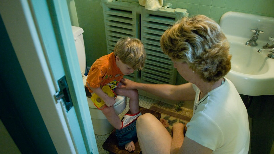 A 3-year-old learns how to use the toilet.