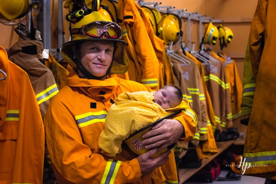 Australian firefighter holds newborn in now-viral photo