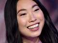 Awkwafina poses with her long, blunt-cut hair, one of the top long haircut trends of the year.