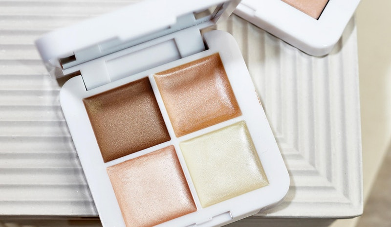 RMS Beauty's new Living Luminizer Glow Quad Mini featuring four highlighter and bronzer shades.