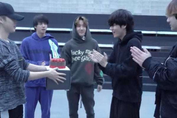 A screenshot from the video of BTS' surprise party for V's 24th birthday.