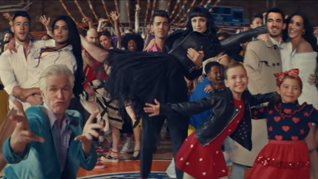 """A screenshot from the Jonas Brothers' """"What A Man Gotta Do"""" video."""