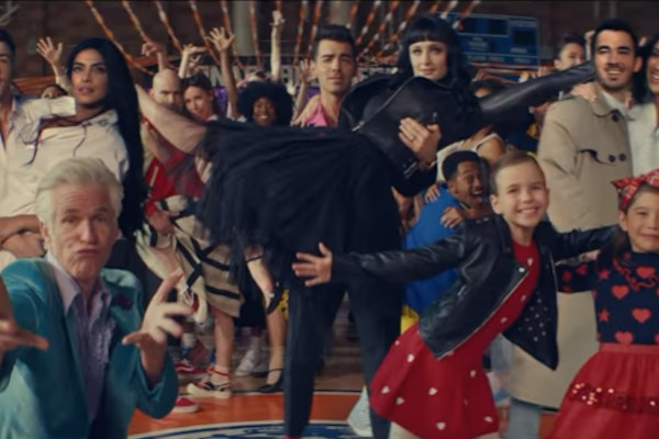 "A screenshot from the Jonas Brothers' ""What A Man Gotta Do"" video."