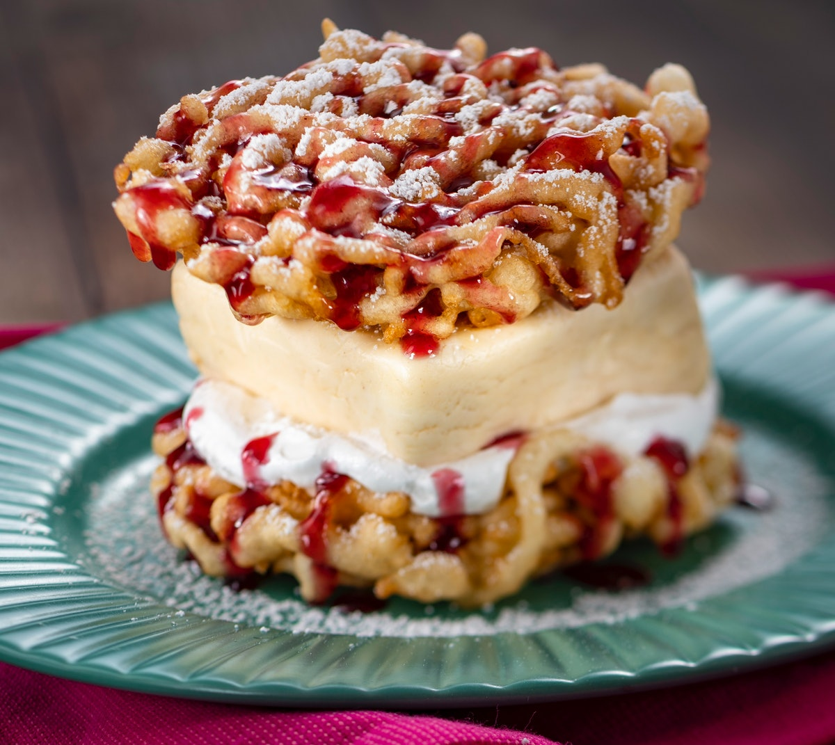 The Peanut Butter and Jelly Funnel Cake served at Epcot's International Festival of the Arts sits on...