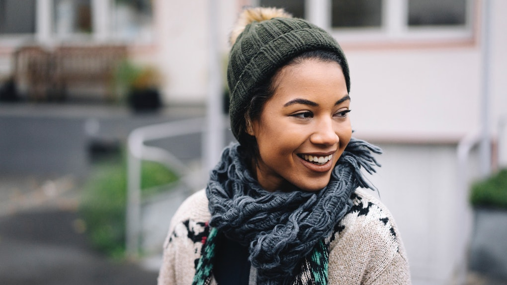 Young Black woman happy with scarf