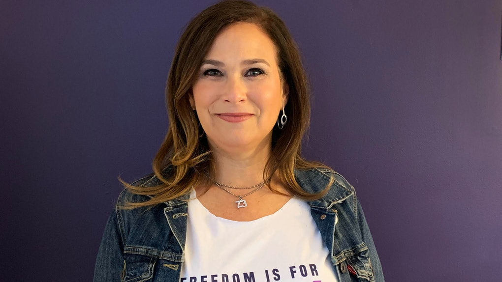 "NARAL President Ilyse Hogue poses in a shirt reading ""Freedom is for every body"""