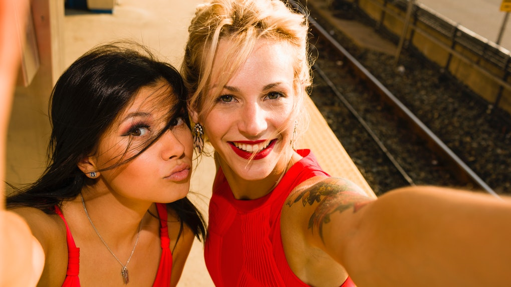 Two girl friends wearing red dresses, Valentine's Day