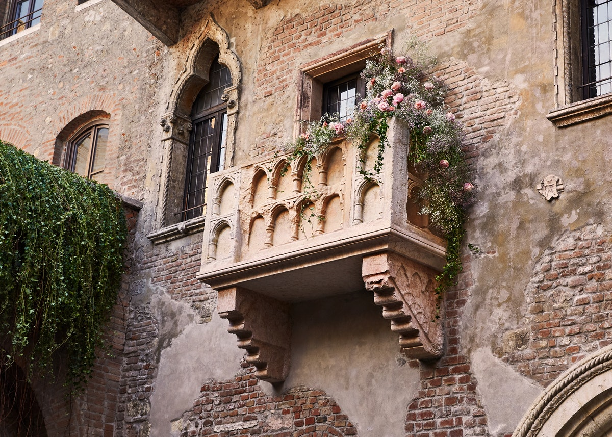 Juliet's balcony covered in pretty flowers overlooks Verona at the 'Romeo and Juliet'-inspired house...
