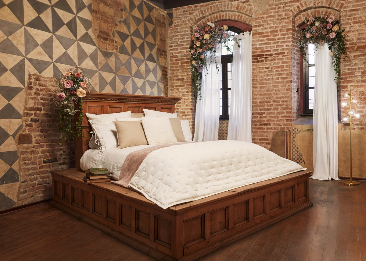 The bed from 'Romeo and Juliet' sits in the center of a 'Romeo and Juliet' inspired home on Airbnb i...