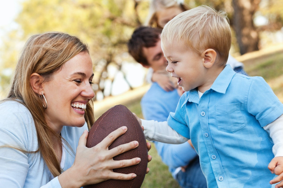 Mother and child with football.