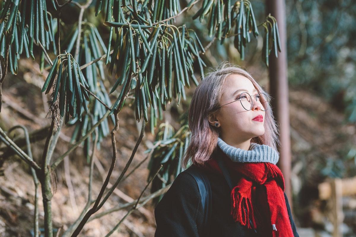 Blonde Asian woman in winter