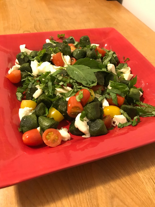 Trader Joe's Kale Gnocchi pairs well with mozzarella, tomatoes, and basil.
