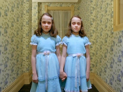 The twins in the shining stand in blue dresses in the hallway
