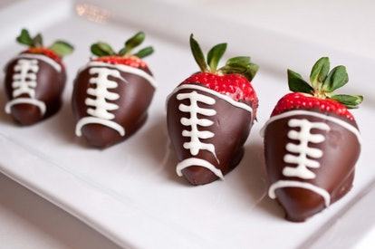 Chocolate-covered strawberry footballs are an easy Super Bowl dessert.