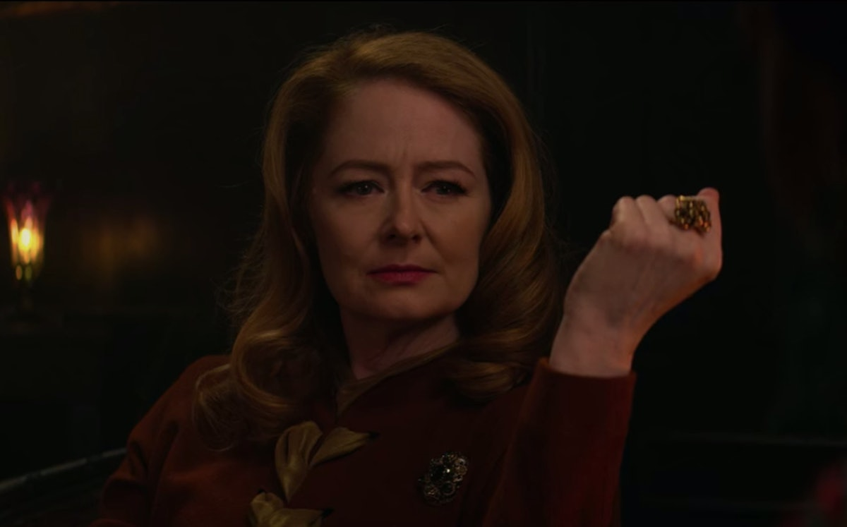 Zelda looking at Mambo Marie in 'Chilling Adventures Of Sabrina'