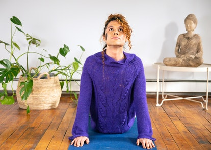 A genderfluid person practicing yoga. Yoga has a longer history than Pilates, which is a 20th century European creation.