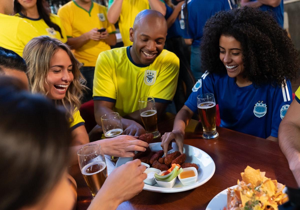 Football fans eating snacks during Super Bowl