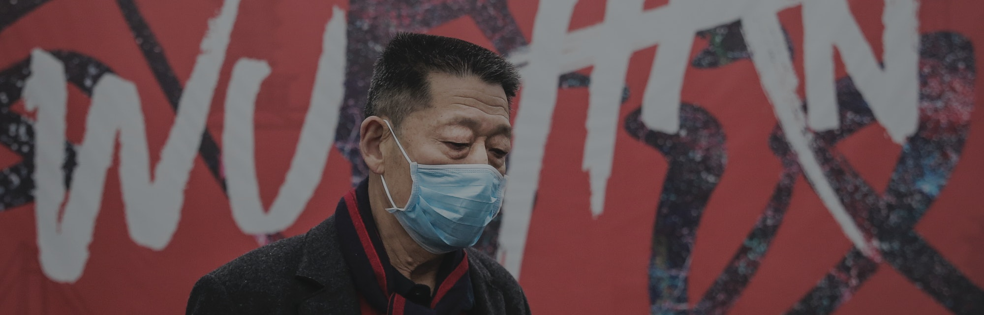 "WUHAN, CHINA - JANUARY 22: (CHINA OUT) A man wears a mask while walking in the street on January 22, 2020 in Wuhan, Hubei province, China. A new infectious coronavirus known as ""2019-nCoV"" was discovered in Wuhan as the number of cases rose to over 400 in mainland China. Health officials stepped up efforts to contain the spread of the pneumonia-like disease which medicals experts confirmed can be passed from human to human. The death toll has reached 17 people as the Wuhan government issued regulations today that residents must wear masks in public places. Cases have been reported in other countries including the United States, Thailand, Japan, Taiwan, and South Korea. (Photo by Getty Images)"