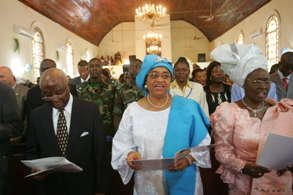 Liberian President elect Ellen Johnson-Sirleaf, sings during a church service in Monrovia, Liberia i...
