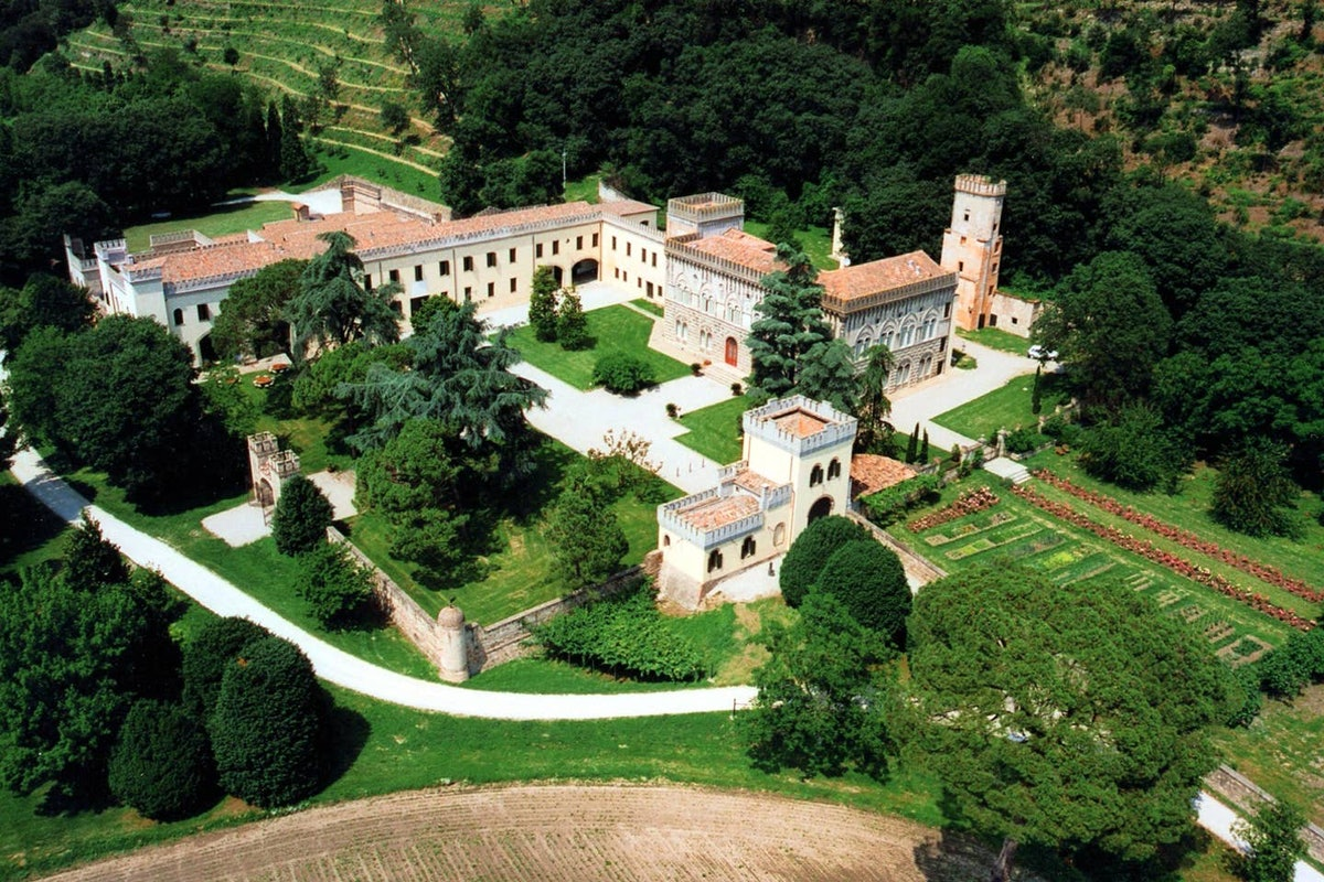 From above, you can see the green land surrounding a massive white castle in Italy that's listed on Airbnb.