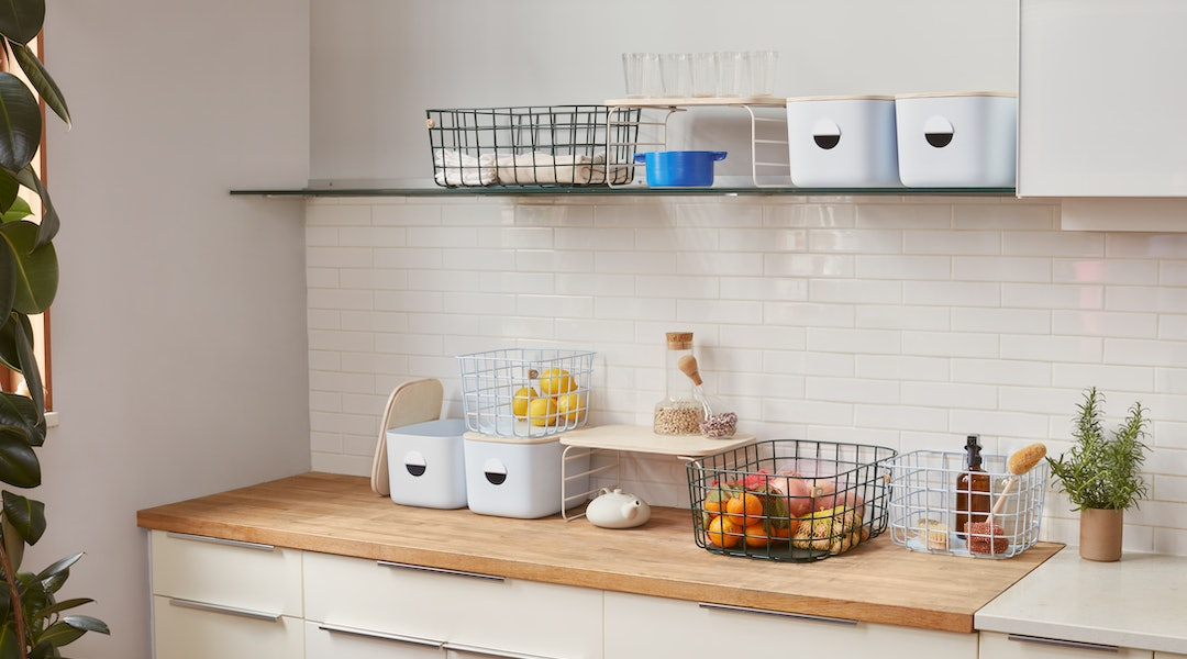 Kitchen bins, baskets, and more from home organization brand, Open Spaces.