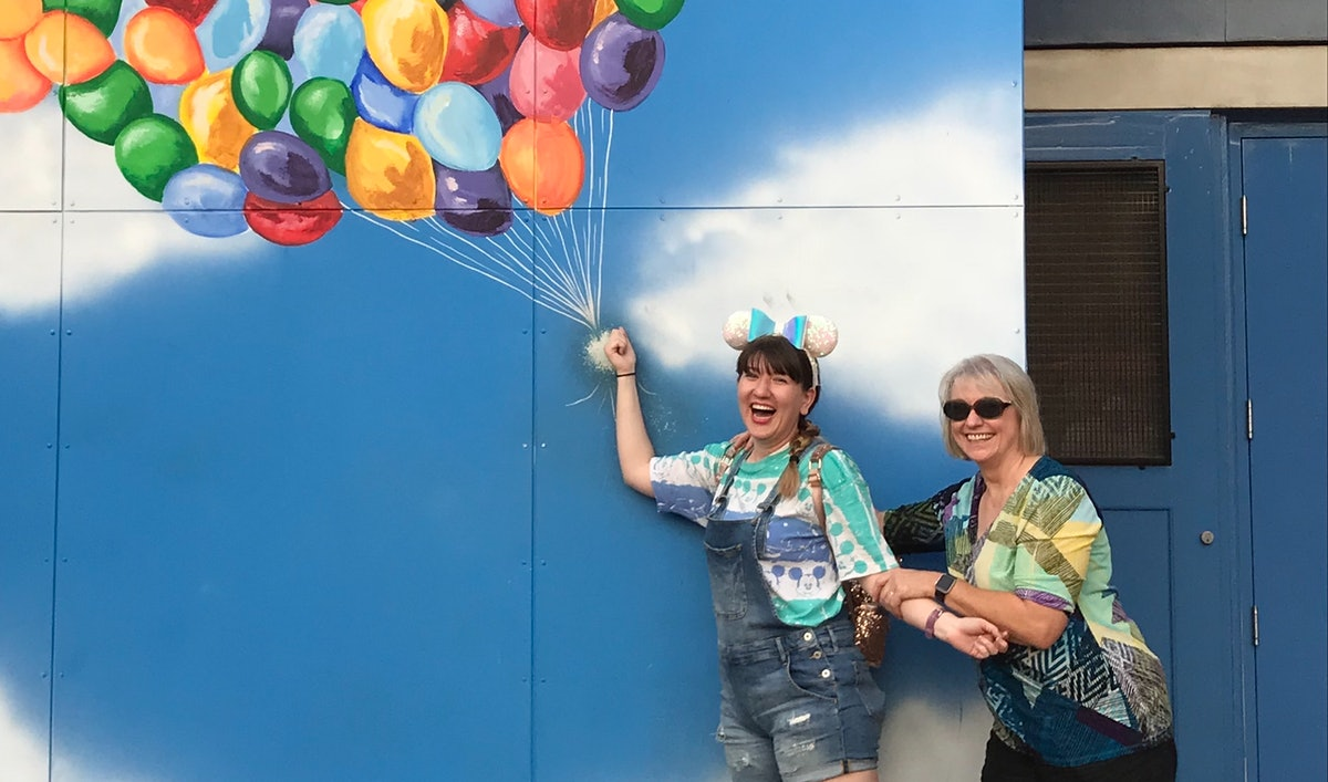 A mother and daughter celebrate the mom's birthday at Disneyland.