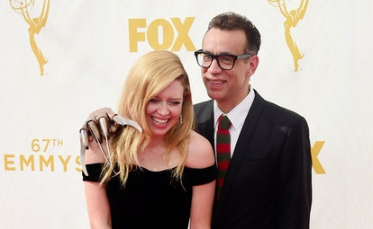 Natasha Lyonne and Fred Armisen with a Freddy Krueger hand and tie on the red carpet at the 2015 Emmys