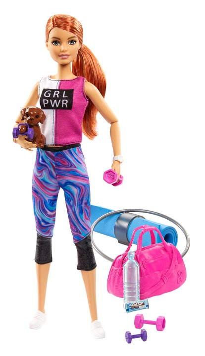 Fitness Barbie comes with plenty of accessories, too.
