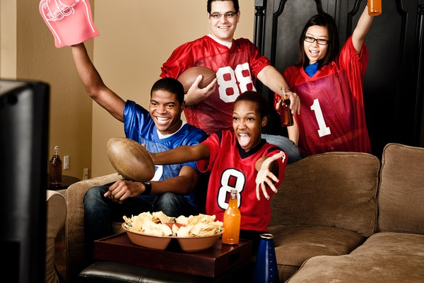Football fans cheering on the Super Bowl