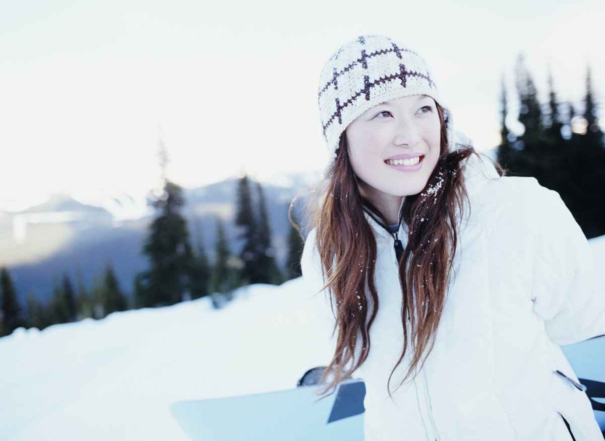 Young Asian woman happy in snow, winter