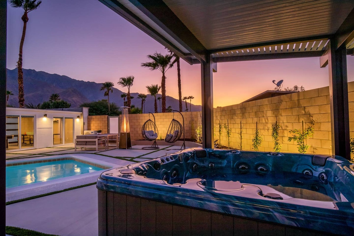 A jacuzzi sits in the backyard of a Palm Springs home at sunset.