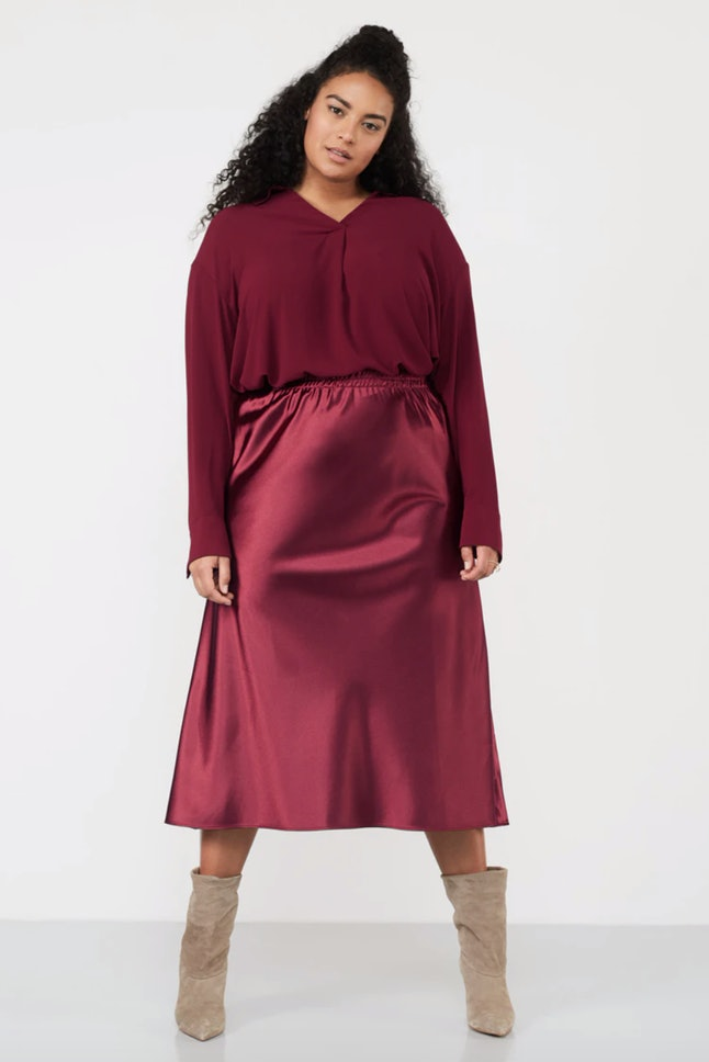 For a more winter-appropriate take on Sienna Miller's Golden Globes Gucci gown, try this satin Navabi skirt