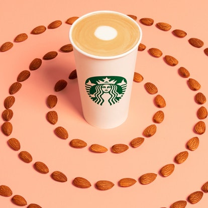 The new Starbucks Almondmilk Flat White features steamed almond milk, a Blonde espresso shot, and a hint of honey.