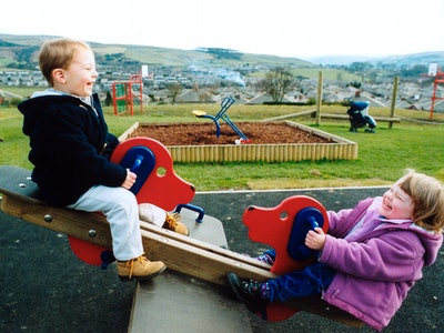 Small children playing on seesaw in North Yorkshire.