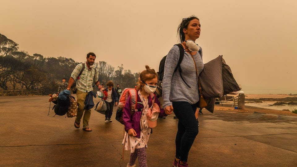 People stranded in Mallacoota, Victoria are evacuated by army personnel to the HMAS Choules after bushfires ravaged the town on December 30th on January 3, 2020 in Mallacoota, Victoria, Australia.