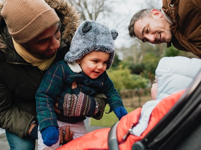 two dads introduce their toddlers on a cold winter's day