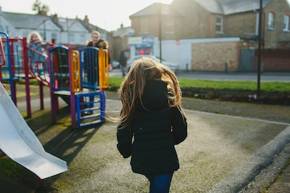 A girl plays on a playground