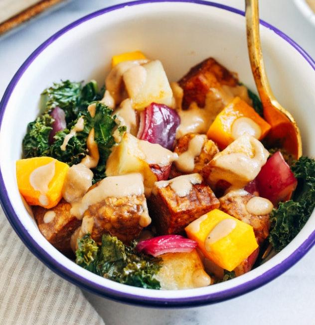 Tempeh sheet pan recipe from Making Thyme for health features seasonal veggies and tahini paste